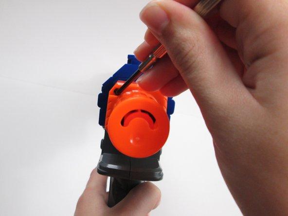 Image 2/3: Pull off the orange cap.