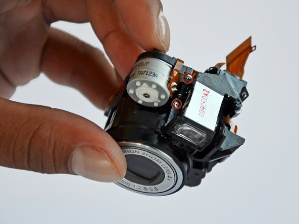 Remove the two 2mm Phillips #00 screws on the top of the lens piece.
