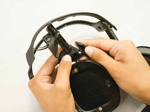 Use your fingers to remove the black wire from your headphones.