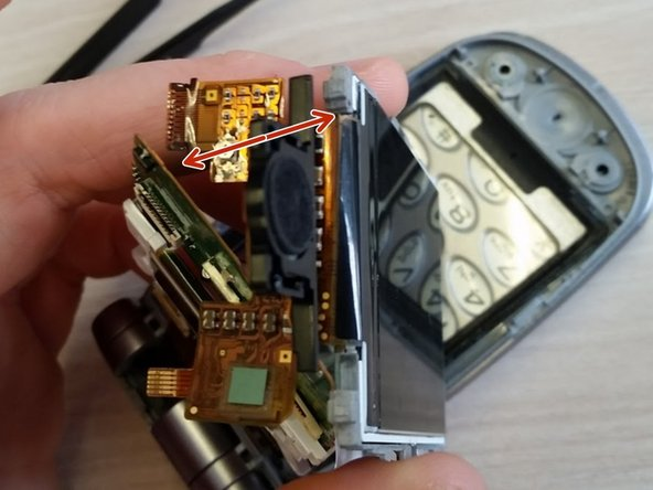 After the screen should only remain attached to gray component due to the ribbon at the top which connects the screen to the circuit board.