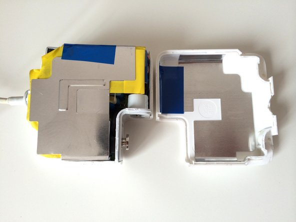 Image 2/2: Gently pull the two halves of the case apart.