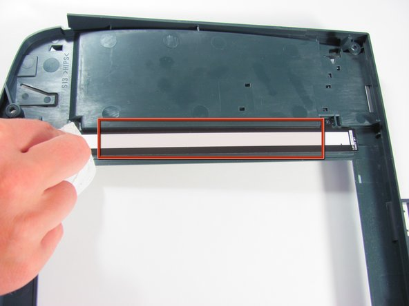 Turn the scanner glass over and place it on a clean surface.