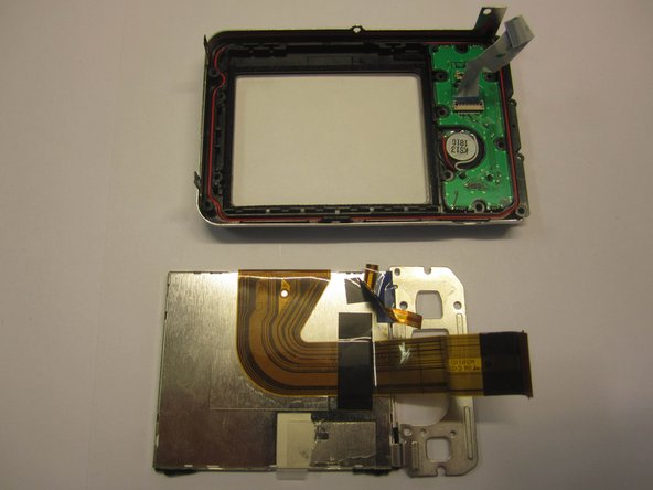 Carefully lift out the lcd screen component from the camera casing.