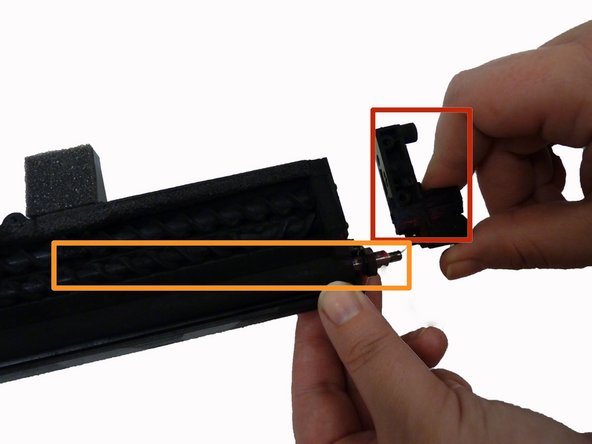 Image 1/1: Gently pull out black toner roller.