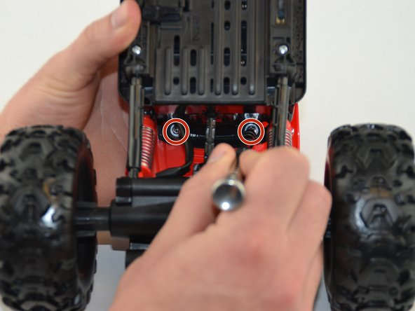 Image 1/2: To take off the R/C truck top, use the driver and bit PH2 and remove the four  7.7mm Philips screws highlighted.