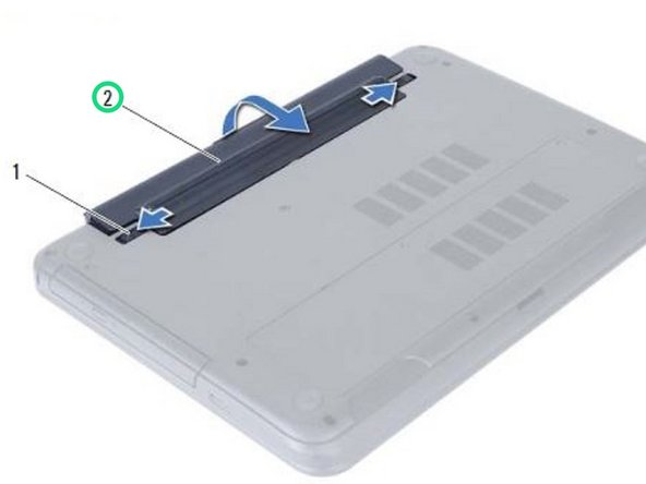 Align the tabs on the NEW battery with the slots on the battery bay and snap the battery into place.