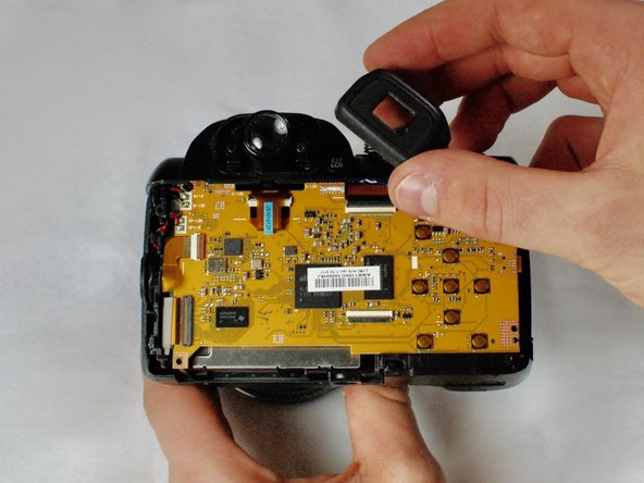 Lift and remove viewfinder cover