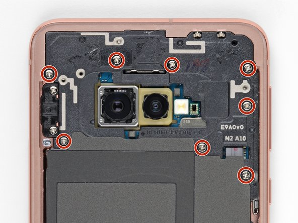 Remove the eight 3.9 mm Phillips screws securing the upper midframe to the phone.