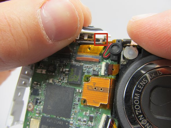To reattach the speaker housing to the rest of the camera, make sure the pins and clips are aligned.