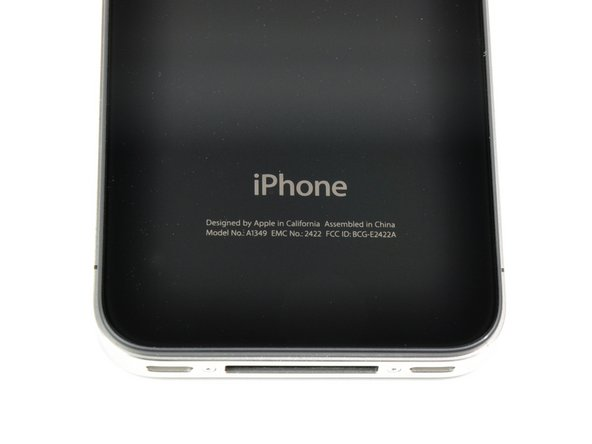 Image 2/2: On the back, Apple's [guide|3130|removed the visual warning|stepid=15333] to not throw your iPhone 4 in the trash.