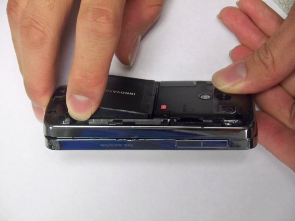 Use finger to lift up an edge of battery.