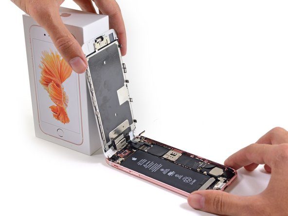 Remove the display assembly from the rear case.