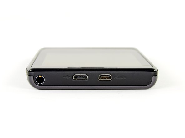 Image 1/3: The micro-USB and micro-HDMI ports are located at the top of the phone, next to the 3.5 mm headphone jack.