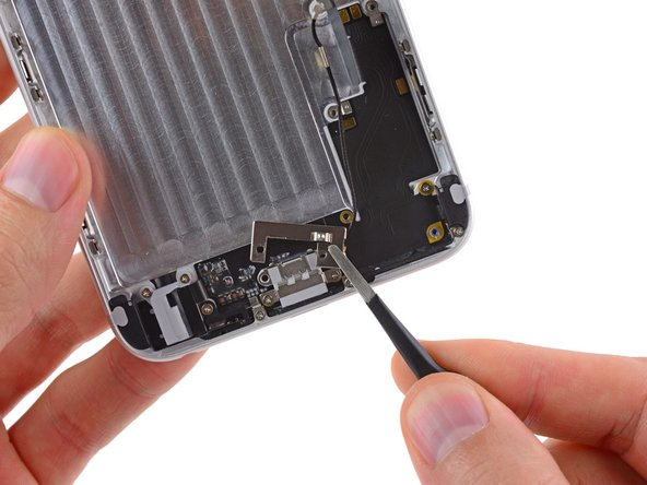 Use a pair of tweezers to lift and remove the metal bracket out of the iPhone.
