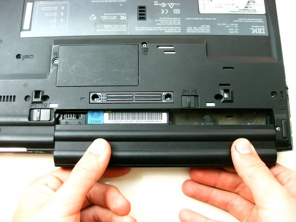 Image 3/3: Grasp the battery and pull it straight out - not at an angle.