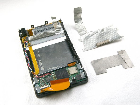 Remove two more pieces of silver tape from the bottom of the device. One of these pieces is below the other.