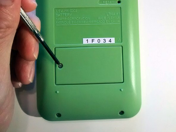 Image 2/3: Ensure the screw hole on the left hand side aligns with the screw hole on the battery compartment housing.