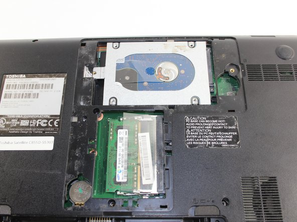 Locate the hard drive. It is in a metal casing as pictured.