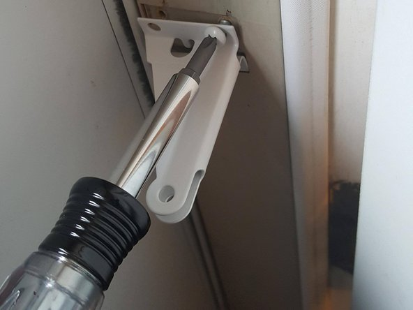 Attach the new bracket to the door jamb with provided screws.