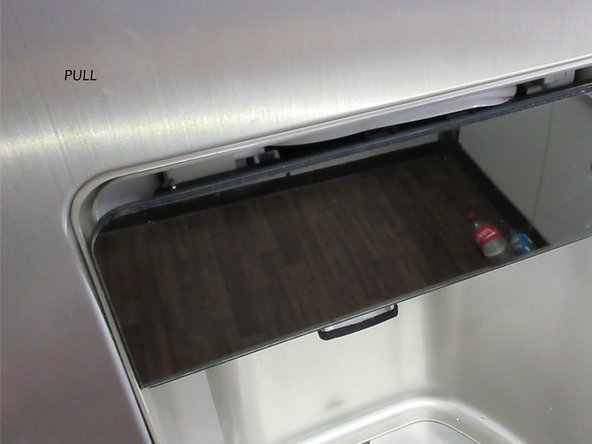 PULL the complete display. Shake it a little because the flap of the ice-crusher could be frosted.