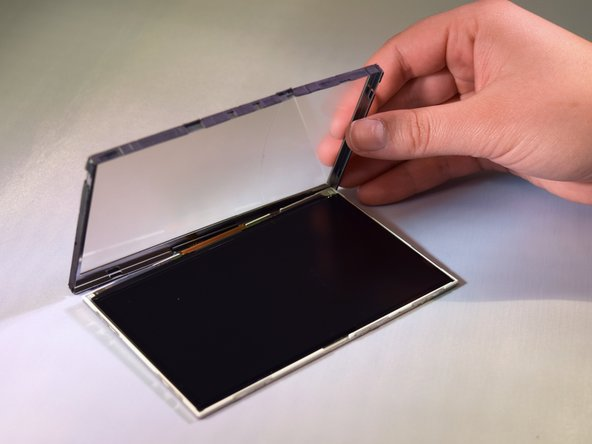 Using the spudger, gently pry the sides of digitizer open until it lifts open and remove the digitizer from the LCD screen.