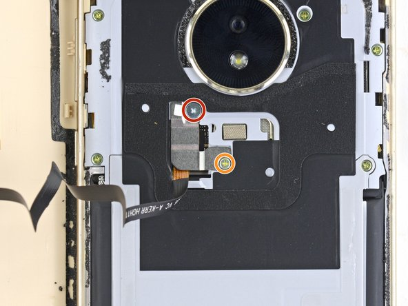 Remove the following Phillips screws securing the fingerprint sensor cable cover: