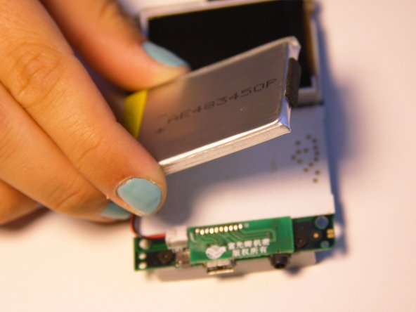 Carefully slide the battery off of the motherboard.