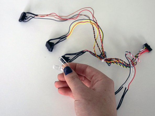 Image 2/3: The other should be placed on the sensor with red and brown wires.