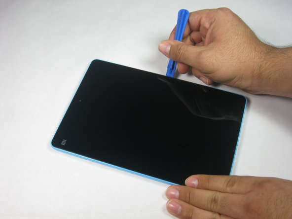 Image 1/2: The back panel has small clips and light adhesive that easily releases from the device.