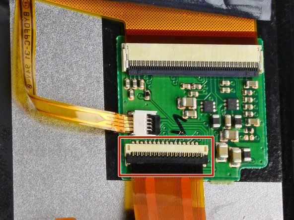 Use a spudger to flip back the black bar on the LCD Ribbon ZIF connector.