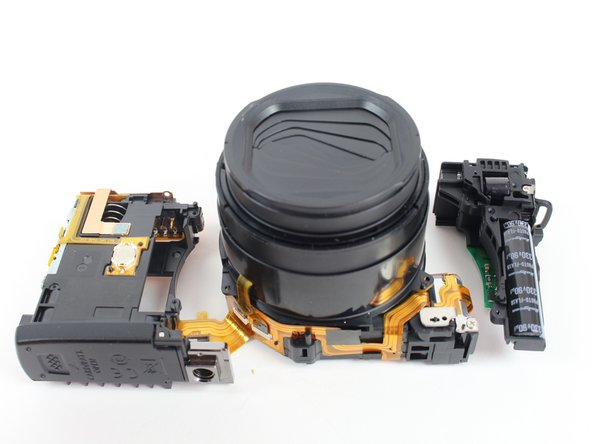 Separate the lens from the other components of the camera.