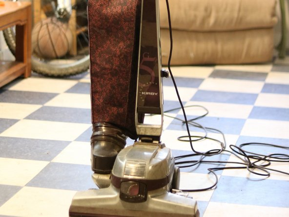 To prevent any injury, start by making sure the vacuum is unplugged and turned off.