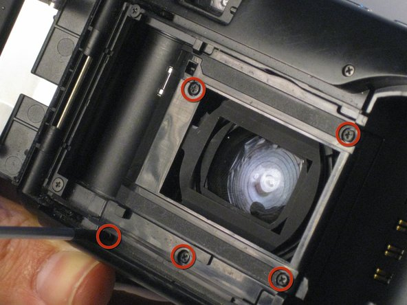 Having opened the camera and removed the bottom plate, unscrew the five screws marked in the picture.