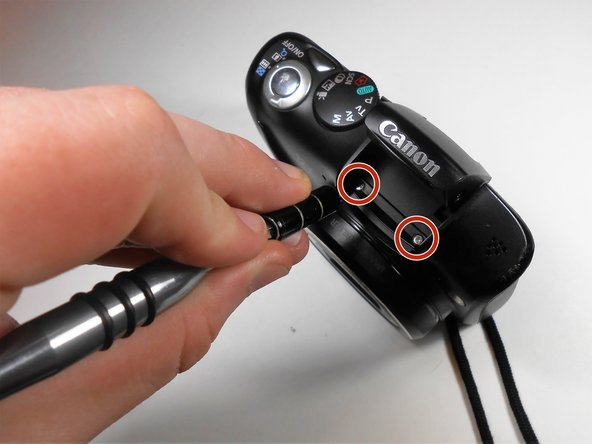 With the J000 Philips head screwdriver, remove the two 2mm screws from under the flash.