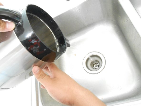 Pour the boiling water down the sink to flush out any remaining debris.