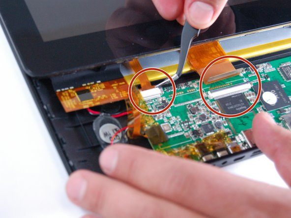 Next, carefully remove the display ribbons from the motherboard by using tweezers.