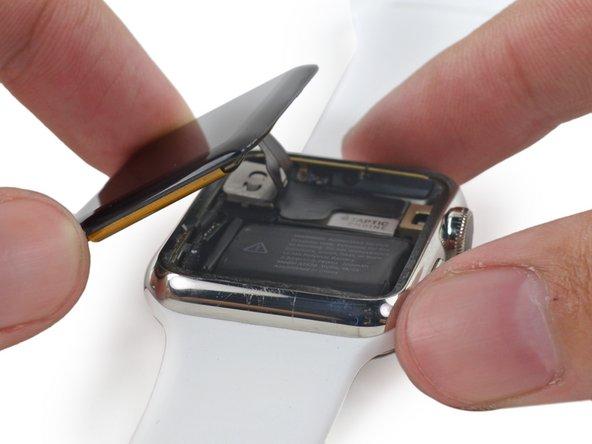Soulevez l'écran et faites-le passer sur le côté gauche, en faisant attention aux câbles de l'écran et du digitizer.