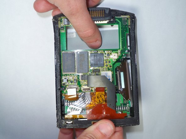 Using your thumb, press down gently on the back of the LCD.