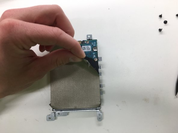Be careful not to tear the cover on the side of the drive as you peel it off.