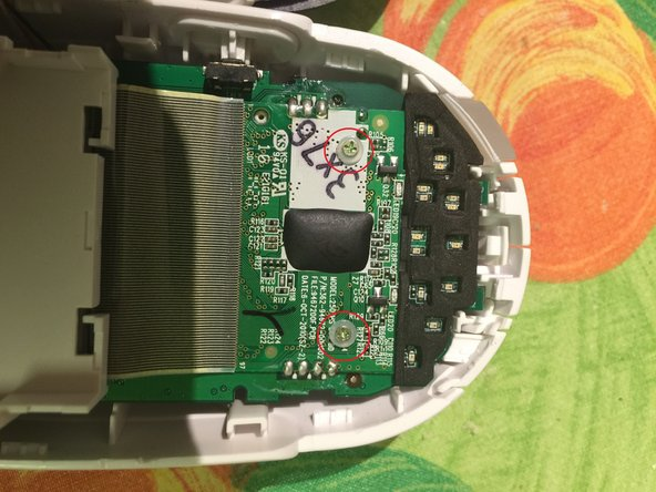 Image 1/1: Remove the single screw in the middle of the lower part of the PCB