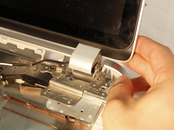 Remove the screen by pulling it forward from the casing. This allows the hinges to clear the casing.