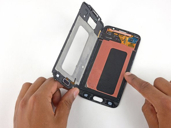 Image 2/3: Once you've lifted the frame past 90 degrees, thread the digitizer cable through its hole in the display frame and separate the frame from the display assembly.