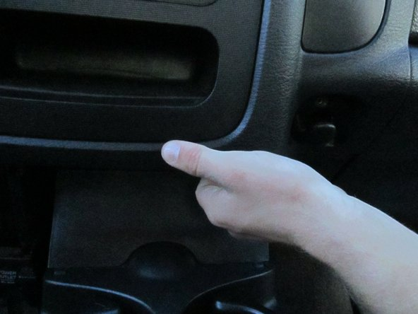 Image 1/3: Be careful when popping off the console trim.  Delicate wires controlling the AC and cigarette lighter are attached to the front face.  A forceful pull may break the connections.