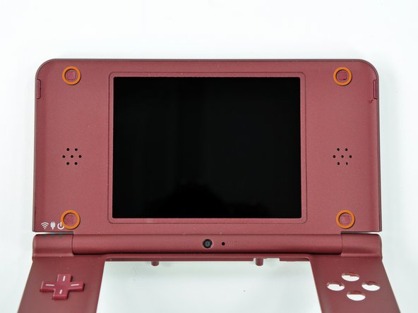 Image 1/3: When re-assembling the device, be sure to re-install the ABXY and Start/Select buttons, as they are likely to fall out once the handheld console is turned over.