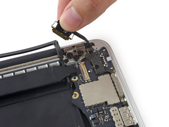 Image 3/3: Gently bend the display data cable toward the display hinge, to expose the screws on the MagSafe 2 board.