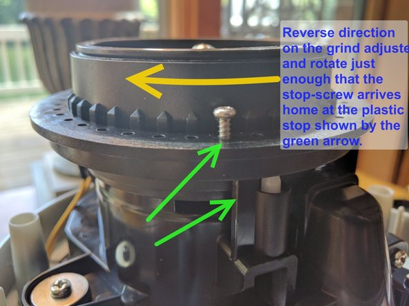 With the upper-burr-holder all the way down, reverse direction on the grind-adjuster and rotate through 50% to 75% of a rotation.