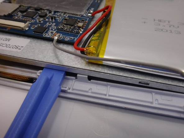 Image 2/2: Leave the plastic opening tool in place to prop the metal backing.