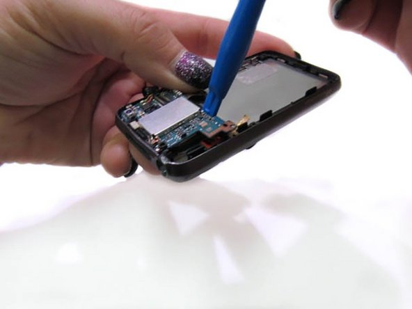 Image 1/2: Once the circuit board is lifted, carefully remove the chip with tweezers.
