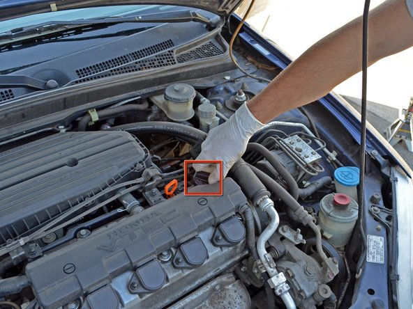 Image 1/3: Locate your oil filler cap.  It's on the top-right of your engine block. Unscrew it (counter-clockwise).