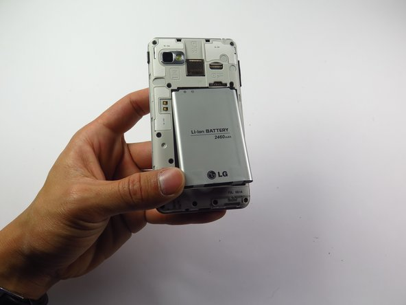 Place the battery into the open socket on the back of the rear case.
